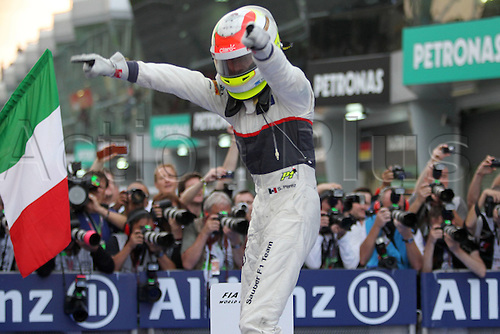 25.03.2012. Kuala Lumpur Malaysia.   FIA Formula One World Championship 2012 Grand Prix of Malaysia 15 Sergio Perez MEX clean F1 team jumps from his car in celebration