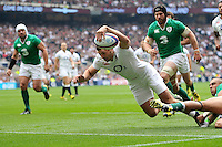 Jonny May of England dives for the try-line. QBE International match between England and Ireland on September 5, 2015 at Twickenham Stadium in London, England. Photo by: Patrick Khachfe / Onside Images