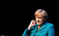 """Berlin, Donnerstag (02.05.13), Bundeskanzlerin Angela Merkel (CDU) sitzt bei einem öffentlichen Interview der Zeitschrift Brigitte im Rahmen der Gesprächsreihe """"Brigitte live - Frauen wählen"""" auf der Bühne. Foto: Michael Gottschalk/CommonLens"""
