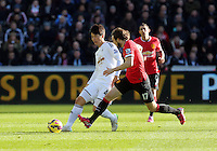 SWANSEA, WALES - FEBRUARY 21: L-R Ki Sung Yueng of Swansea is challenged by Daley Blind of Manchester United during the Barclays Premier League match between Swansea City and Manchester United at Liberty Stadium on February 21, 2015 in Swansea, Wales.