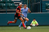 Rochester, NY - Saturday May 21, 2016: Western New York Flash forward Jessica McDonald (14) is marked by Sky Blue FC defender Erica Skroski (8). The Western New York Flash defeated Sky Blue FC 5-2 during a regular season National Women's Soccer League (NWSL) match at Sahlen's Stadium.