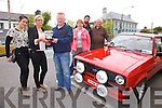 Brendan Shanahan from Abbeydorney pictured here in Cahersiveen on Saturday at the KVVC Ring of Kerry Tour being presented with The Colm Foley Perpetual Trophy for his 1978 Ford Escort Mark II, l-r; Emma Kenny, Alanna Kelleher(Cahersiveen's Lord Mayor hopeful), Brendan Shanahan, Margaret Shanahan, David Curran(Chairman KVVC) & P.J.O'Riordan(President KVVC).