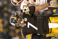 28 November 2004:  Ben Roethlisberger smiles as he picks turf out of his helmet after being sacked.<br />