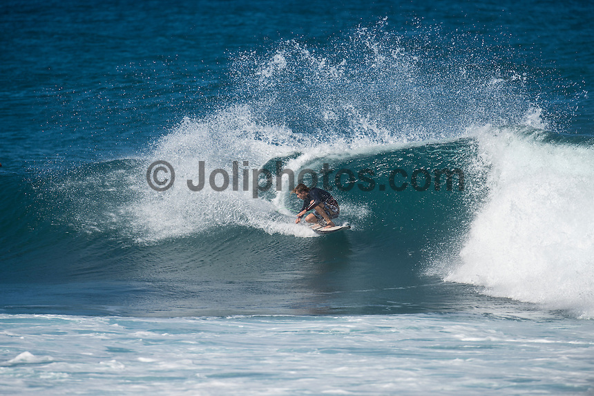 Rocky Point, North Shore of Oahu, Hawaii.  Saturday December 5 2014) - Bryce Young (AUS). The surf was in the 4'-6' range at Rocky Point today with a bumpy  NW swell and side NE Trade winds. Photo: joliphotos.com
