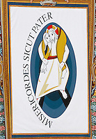Un arazzo col logo del Giubileo della Misericordia sulla facciata della Basilica di San Pietro durante la messa celebrata da Papa Francesco per l'apertura ufficiale in Piazza San Pietro, Citta' del Vaticano, 8 dicembre 2015.<br /> A tapestry with the logo of the Jubilee of Mercy on the facade of St. Peter's Basilica, during the mass celebrated by Pope Francis for its official opening, in St. Peter's Square at the Vatican, December 8, 2015.<br /> UPDATE IMAGES PRESS/Riccardo De Luca<br /> <br /> STRICTLY ONLY FOR EDITORIAL USE
