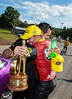 Sep 16, 2018; Mohnton, PA, USA; NHRA pro stock driver Vincent Nobile (left) celebrates with brother in law, pro stock motorcycle rider Hector Arana Jr after winning the Dodge Nationals at Maple Grove Raceway. Mandatory Credit: Mark J. Rebilas-USA TODAY Sports