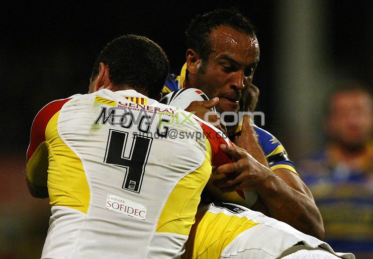 PICTURE BY VAUGHN RIDLEY/SWPIX.COM - Rugby League - Super League Playoffs - Leeds v Catalans - Headingley, Leeds, England  - 02/10/09...Copyright - Simon Wilkinson - 07811267706...Leeds Jamie Jones-Buchanan is tackled by Catalans Adam Mogg.