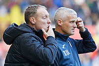 (L-R) Swansea City manager Steve Cooper watches the game with Assistant First Team Coach Mike Marsh during the Sky Bet Championship match between Swansea City and Cardiff City at the Liberty Stadium, Swansea, Wales, UK. Sunday 27 October 2019