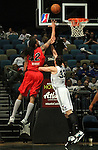Idaho Stampede's Mikki Moore gets fouled by Reno Bighorns' Christopher Ayer during a basketball game Sunday, April 1, 2012 in Reno, Nev. Idaho won 108-99..Photo by Cathleen Allison
