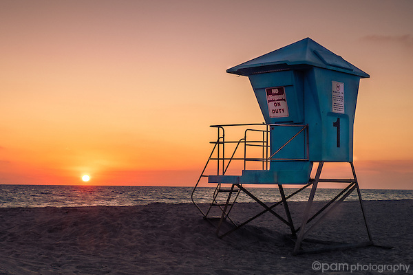 Sunset on California beach with lifeguard station
