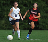 Amy Armata #8 of St. Dominic, left, and Christina Loizou #10 of Long Island Lutheran chase after a loose ball during a varsity girls soccer game at Charles Wang Athletic Complex in Muttontown on Monday, Oct. 3, 2016. St. Dominic won by a score of 6-4.