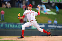 Starting pitcher Trey Ball (24) of the Greenville Drive delivers a pitch in a game against the Rome Braves on Thursday, July 31, 2014, at Fluor Field at the West End in Greenville, South Carolina. Ball was a first-round pick of the Boston Red Sox (seventh overall) in the 2013 First-Year Player Draft. Rome won the rain-shortened game, 4-1. (Tom Priddy/Four Seam Images)