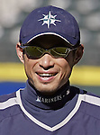 Seattle Mariners' Ichiro Suzuki smiles as he talks to a teammate before their game against the New York Yankees in Seattle, Washington on Wednesday, 31 August, 2005.Jim Bryant Photo. ©2010. ALL RIGHTS RESERVED.