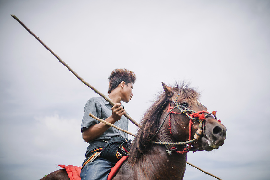 A Pasola warrior ready to charge the enemy forces during the event in Waiha, Kodi. Pasola is an ancient tradition from the Indonesian island of Sumba. Categorized as both extreme traditional sport and ritual, Pasola is an annual mock horse warfare performed in response to the harvesting season. In the battelfield, the Pasola warriors use blunt spears as their weapon. However, fatal accident still do occurs.