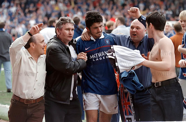 Rino Gattuso mobbed by fans as the final whistle ends Rangers season in disappointment at Tannadice in 1998 with failure to clinch 10-in-a-row