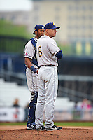 Burlington Bees manager Adam Melhuse (6) makes a pitching change as catcher Angel Genao look on during a game against the Quad Cities River Bandits on May 9, 2016 at Modern Woodmen Park in Davenport, Iowa.  Quad Cities defeated Burlington 12-4.  (Mike Janes/Four Seam Images)