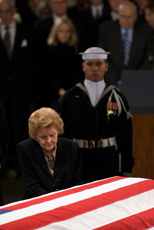 Betty Ford pauses over the coffin of her husband, former President Gerald Ford, during the state funeral for Ford in the Rotunda of the U.S. Capitol in Washington on Saturday evening, Dec. 30, 2006.