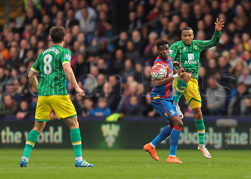 09.04.2016. Selhurst Park, London, England. Barclays Premier League. Crystal Palace versus Norwich. Norwich City Defender Martin Olsson wins a header against Crystal Palace Forward Wilfried Zaha, and heads on to Norwich City Midfielder Jonathan Howson