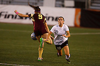 Penn's Maya Lacognato (12) collides with Brebeuf Jesuit's Lizzy Case (9) during the IHSAA Class 2A Girls Soccer State Championship Game on Saturday, Oct. 29, 2016, at Carroll Stadium in Indianapolis. Special to the Tribune/JAMES BROSHER