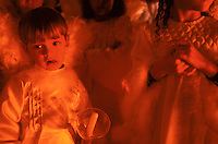 A young angel awaits his turn to parade through the streets with hundreds of citizens dressed as biblical figures during one of Holy Week's many processions in Ouro Prêto.
