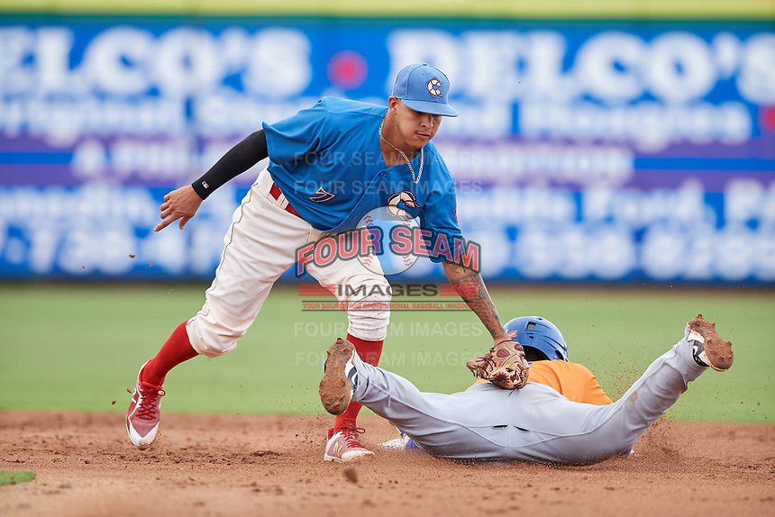 Clearwater Threshers shortstop Arquimedes Gamboa (7) tags Luis Carpio (11) as he slides into second base during a game against the St. Lucie Mets on August 11, 2018 at Spectrum Field in Clearwater, Florida.  St. Lucie defeated Clearwater 11-0.  (Mike Janes/Four Seam Images)