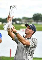26th July 2020, Blaine, MN, USA;  Michael Thompson hoists the trophy he was presented for winning the 3M Open golf tournament at TPC Twin Cities in Blaine, Minnesota