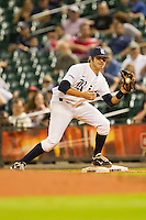 Second baseman Christian Stringer #5 of the Rice Owls fields a throw at first base against the Texas Longhorns at Minute Maid Park on March 2, 2012 in Houston, Texas.  The Longhorns defeated the Owls 11-8.  Brian Westerholt / Four Seam Images