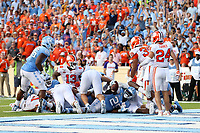 CHAPEL HILL, NC - SEPTEMBER 28: Javonte Williams #25 of the University of North Carolina scores a touchdown during a game between Clemson University and University of North Carolina at Kenan Memorial Stadium on September 28, 2019 in Chapel Hill, North Carolina.