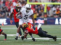 College Park, MD - November 25, 2017: Maryland Terrapins defensive back Antoine Brooks Jr. (25) tackles Penn State Nittany Lions wide receiver DaeSean Hamilton (5) during game between Penn St and Maryland at  Capital One Field at Maryland Stadium in College Park, MD.  (Photo by Elliott Brown/Media Images International)