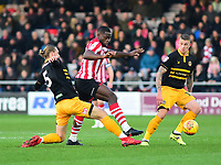Lincoln City's John Akinde battles with  Newport County's Fraser Franks<br /> <br /> Photographer Andrew Vaughan/CameraSport<br /> <br /> The EFL Sky Bet League Two - Lincoln City v Newport County - Saturday 22nd December 201 - Sincil Bank - Lincoln<br /> <br /> World Copyright © 2018 CameraSport. All rights reserved. 43 Linden Ave. Countesthorpe. Leicester. England. LE8 5PG - Tel: +44 (0) 116 277 4147 - admin@camerasport.com - www.camerasport.com