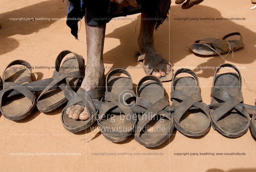 Uganda Karamoja Kotido , Karimojong a pastoral tribe, sale of shoes from rubber tyre / Uganda Karamoja Kotido , Volk der Karimojong, Verkauf von Sandalen aus Autoreifen