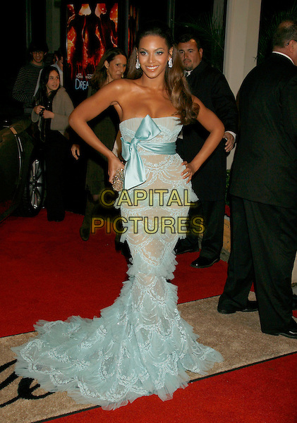 "BEYONCE KNOWLES.""Dreamgirls"" Los Angeles Premiere held at the Wilshire Theatre, Beverly Hills, California, USA..December 11th, 2006.full length blue strapless long gown dress bow sheer beaded ruffles clutch purse silver hands on hips.CAP/ADM/RE.©Russ Elliot/AdMedia/Capital Pictures"