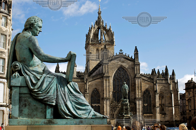 A statue of philosopher David Hume overlooking St Gile's Cathedral on the Royal Mile, Edinburgh.