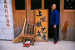 elderly Chinese woman at door of home in rural Three Gorges area of China, Asia