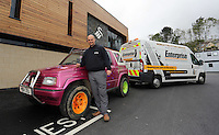 """Pictured: Leigh Evans with his Suzuki Samurai at the Landore Training Ground. Saturday 10 May 2014<br /> Re: Leigh Evans of Leigh Enterprise Tyres is the new owner of """"the pink Ferrari"""", an old Suzuki Samurai 4x4 car used by Swansea City FC players during the last season."""