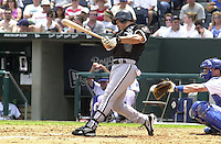 Chicago White Sox right fielder Magglio Ordonez singles to center field in the third inning against the Royals at Kauffman Stadium in Kansas City, Missouri on July 18, 2002.  Catching was A.J. Hinch.  The Royals won 5-3