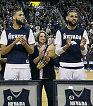 Nevada forwards' Caleb and Cody Martin pose for a photograph with mom Jenny Bennett before an NCAA college basketball game against San Diego State in Reno, Nev., Saturday, Mar. 9, 2019. (AP Photo/Tom R. Smedes)