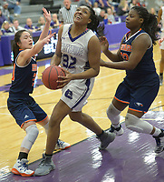 NWA Democrat-Gazette/ANDY SHUPE<br /> Jasmine Franklin (32) of Fayetteville rolls to the basket as she is pressured by Danielle Dickerson (right) and Skylar Brooks (left) of Heritage defend Tuesday, Feb. 13, 2018, during the first half of play in Bulldog Arena in Fayetteville. Visit nwadg.com/photos to see more photographs from the games.