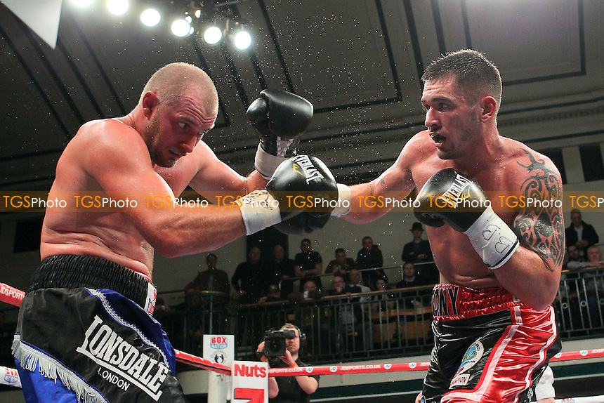 Tony Conquest (black/red shorts) defeats Daniel Ammann in a Cruiserweight Boxing Contest for the Commonwealth Title at York Hall, Bethnal Green, London, promoted by Frank Warren - 23/02/14 - MANDATORY CREDIT: Gavin Ellis/TGSPHOTO - Self billing applies where appropriate - 0845 094 6026 - contact@tgsphoto.co.uk - NO UNPAID USE