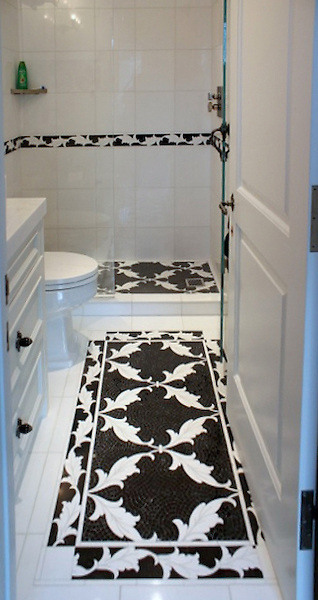 This custom bathroom features a Tamara mosaic rug and custom Tamara border shown in honed Nero Marquina and polished Thassos from the Silk Road Collection by Sara Baldwin for New Ravenna.<br /> -photo courtesy of Beth Fults / Decorative Materials<br /> <br /> For pricing samples and design help, click here: http://www.newravenna.com/showrooms/