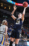 SIOUX FALLS, SD - MARCH 9: Vicky McIntyre #34 of Oral Roberts shoots a layup over Mariah Clarin #40 of SDSU in the second half of their semi-final round Summit League Championship Tournament game Monday afternoon at the Denny Sanford Premier Center in Sioux Falls, SD. (Photo by Dick Carlson/Inertia)