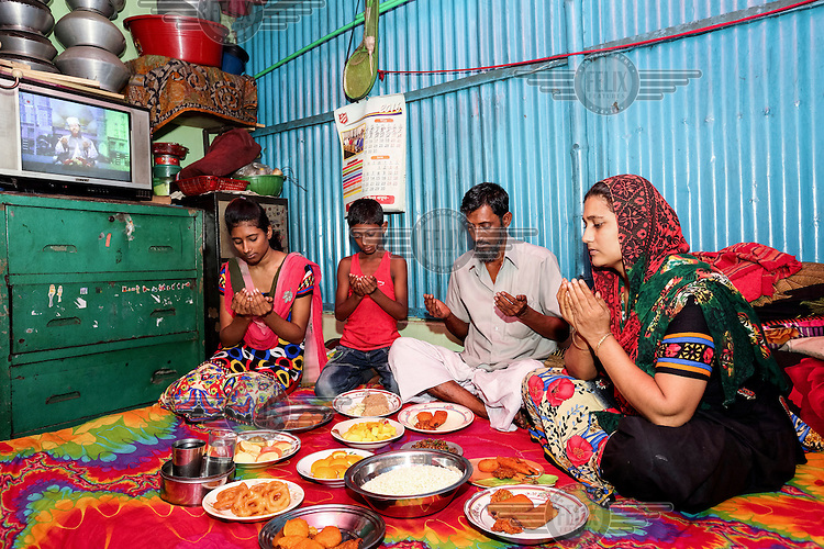 Sheuli Begum and her family break their fast during Ramadan.