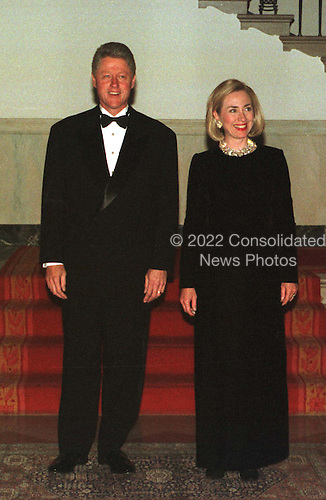 United States President Bill Clinton and first lady Hillary Rodham Clinton pose in front of the Grand Staircase at The White House in Washington, D.C. prior to greeting guests at the dinner honoring the National Medal of Arts recipients on January 9, 1997..Credit: Ron Sachs / CNP