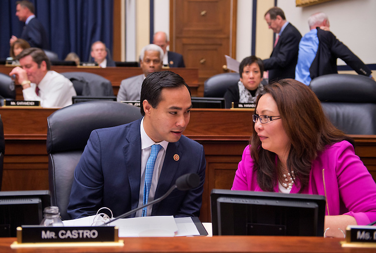 UNITED STATES - JUNE 05: Reps. Joaquin Castro, D-Texas, and Tammy Duckworth, D-Ill., confer during a House Armed Services Committee markup of the National Defense Authorization Act for FY2014 in Rayburn Building. (Photo By Tom Williams/CQ Roll Call)