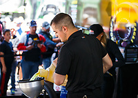 Apr 23, 2017; Baytown, TX, USA; A crew member for NHRA top fuel driver Leah Pritchett pours nitromethane fuel into the tank during the Springnationals at Royal Purple Raceway. Mandatory Credit: Mark J. Rebilas-USA TODAY Sports