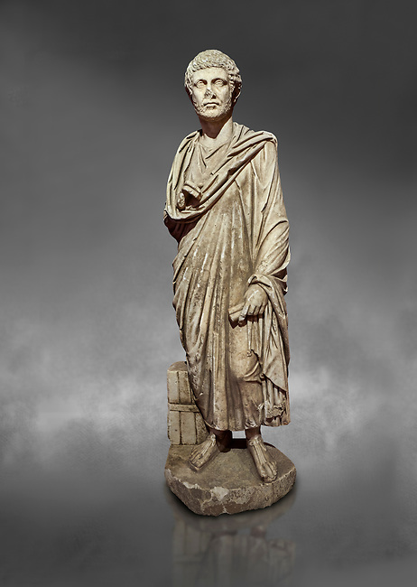 Roman statue of a Clerk. Marble. Perge. 2nd century AD. Inv no 2001/284 . Antalya Archaeology Museum; Turkey.  Against a grey background