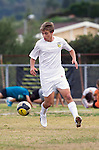 Palos Verdes, CA 01/22/13 - Chase Abelson (Peninsula #7) in action during the West vs Peninsula boys varsity soccer game at Peninsula High School.
