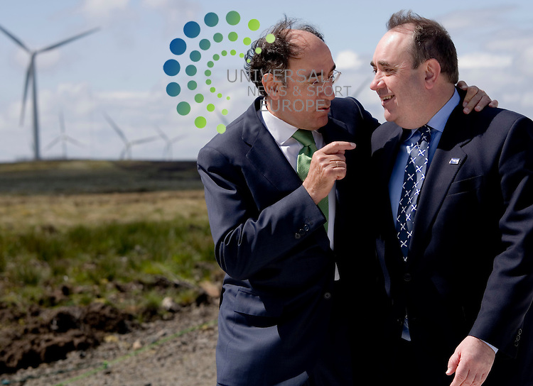 "Alex  Salmond with Scottish Power chairman Ignacio Galan: Europe's largest onshore windfarm has been named overall winner of the Scottish Awards for Quality in Planning..Scottish Power's Whitelee windfarm at Eaglesham Moor impressed the judges with its scale, low level of objections and use of innovative technological solutions..The awards were presented at a ceremony in Edinburgh today by John Swinney, Cabinet Secretary for Finance and Sustainable Growth.Mr Swinney said: ""These awards celebrate the positive contributions that individuals and organisations in both the public and private sector make to enabling high quality development in Scotland.""An efficient planning service is key to delivering strong and sustainable economic growth in Scotland, and particularly to the development of a low carbon economy - something our future success as a nation depends on..Picture  11 March  2010: Universal News and Sport (Scotland).All pictures must be credited to  www.universalnewsandsport.com.(0ffice) 0844 884 51 22."