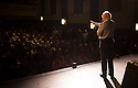 Jim Leishman takes to the stage at a packed Carnegie Hall, Dunfermline, to address the Pars fans.