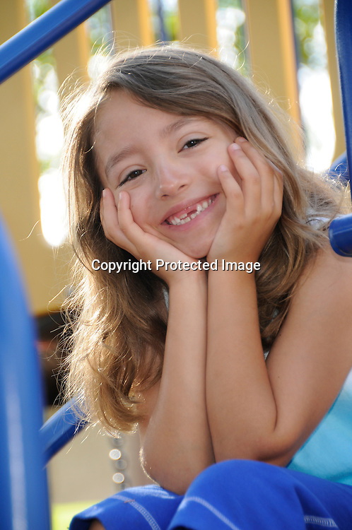 Lifestyle stock photo of adorable little girl playing